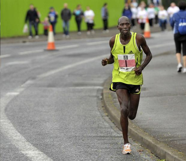 John Mutai of Kenya on his way to a third successive victory in the Belfast Marathon