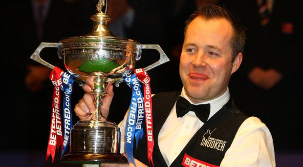 John Higgins with his World Championship trophy after an easy victory over Shaun Murphy