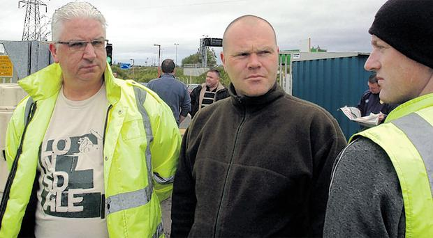 Charlie Maxwell, Kevin Ball and Fra Gillen at the Visteon plant in west Belfast
