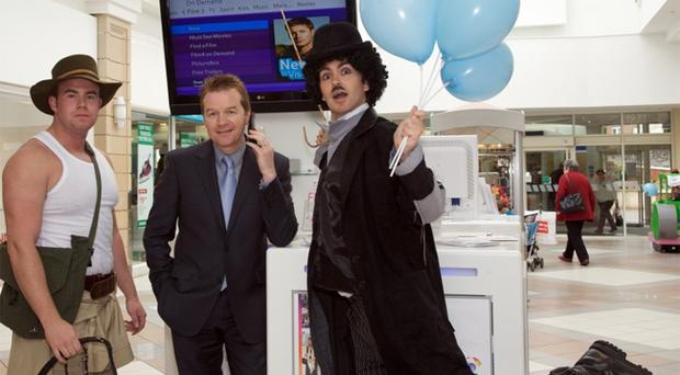 Peter Morris, BT director of consumer and corporate services, launches the new service aided by Indiana Jones and Charlie Chaplin lookaliakes