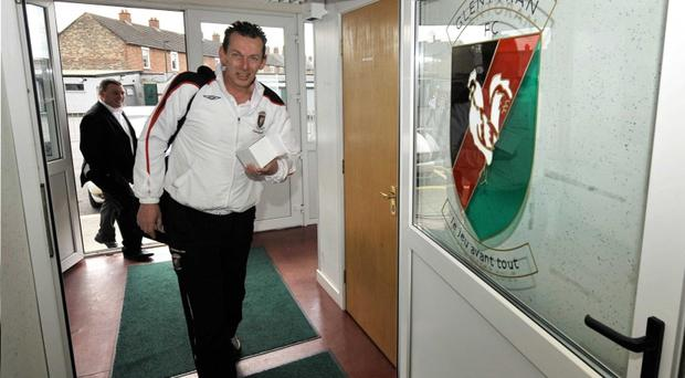 Glentoran manager Alan McDonald hopes to sort out his Oval future today