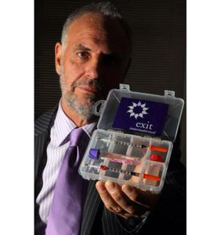The euthanasia campaigner Dr Philip Nitschke with a special testing kit which checks that drugs are strong enough to kill someone