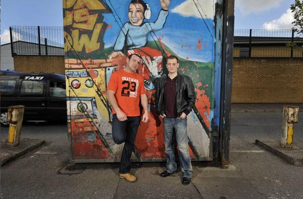Martin Rogan and Neil Sinclair at the Peace line in Belfast are set for a peace trip to Israel