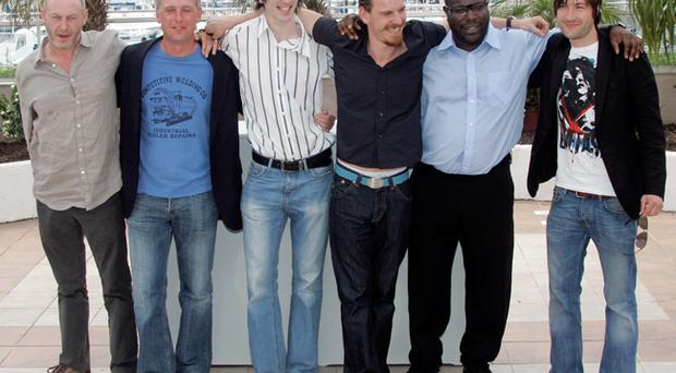 Hunger actors Liam Cunningham, Stuart Graham, Brian Milligan, Michael Fassbender, director Steve McQueen and Liam McMahon pose at the Cannes film festival
