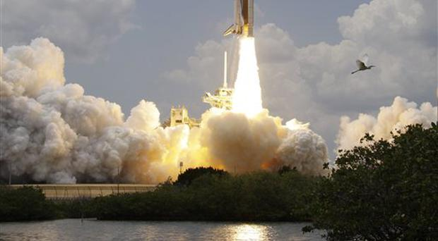 Space Shuttle Atlantis lifts-off at the Kennedy Space Center at Cape Canveral, Fla, on Monday, May 11, 2009. Space Shuttle Atlantis' seven-member crew are on a final mission to service the Hubble Space Telescope. (AP Photo/John Raoux)