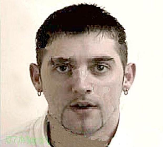 Face of a killer: Colin King escaped while he was on pre-release from Maghaberry Prison, where he was being held for the brutal murder of Bessie Robson