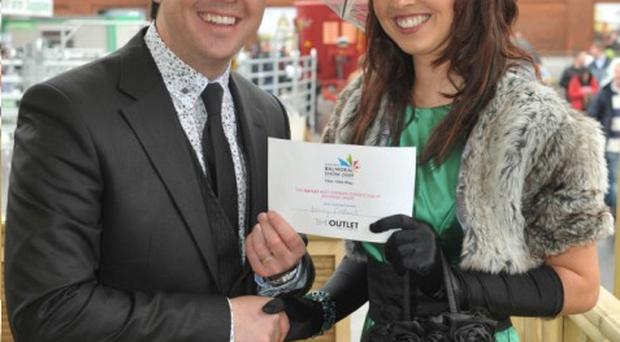 Pete Snodden presents Stacey Caldwell with her best-dressed prize