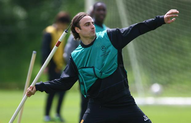 Dimitar Berbatov of Manchester United uses a training pole as a javelin during a Manchester United training session held ahead of next week's UEFA Champions League Final at the Carrington Training Complex
