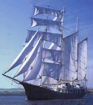 The tall ship Thalassa is a three-masted Barquentine ship with 16 sails