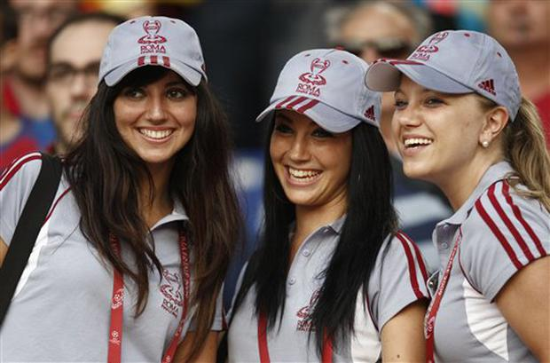 Stadium hostesses smile prior to the UEFA Champions League final soccer match between Manchester United and Barcelona in Rome, Wednesday May 27, 2009. (AP Photo/Luca Bruno)