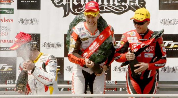 Ian Hutchinson (centre) with Guy Martin (left) and Keith Amor on the podium