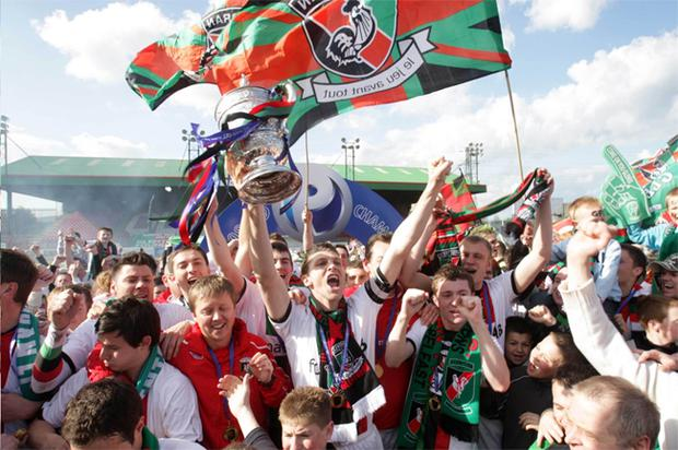 Glentoran players go wild as the Gibson Cup is raised