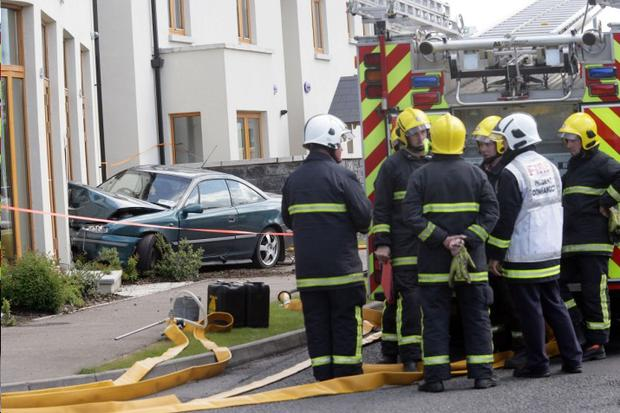 Firefighters at the scene after a car crashed into the front of the Tullana On The Green restaurant in County Fermanagh