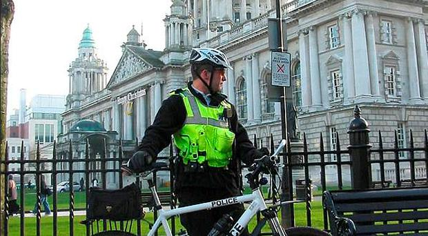On patrol: A police officer with one of the bikes outside City Hall in Belfast