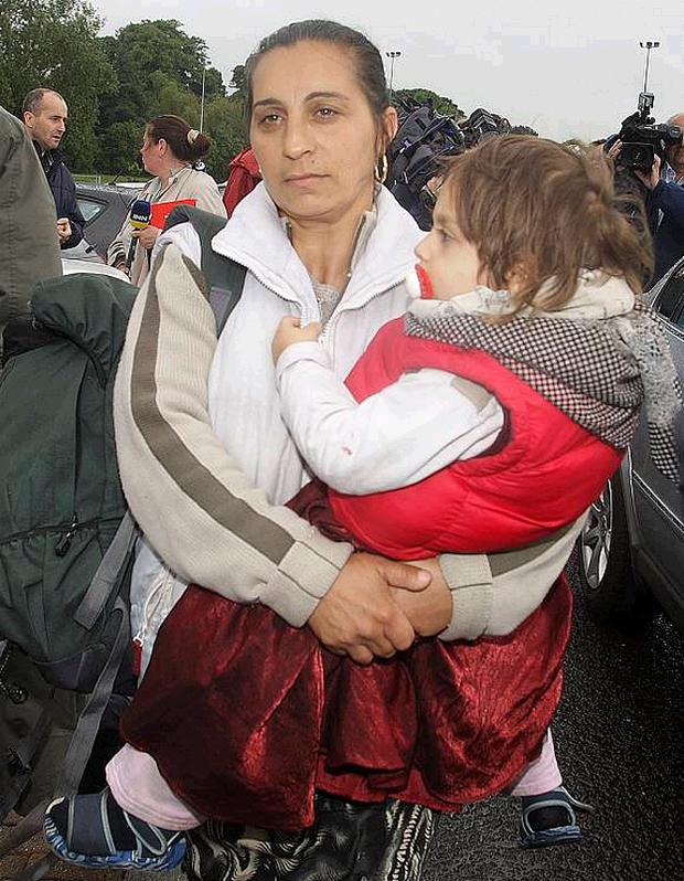 A Romanian woman arrives with her child at the refuge centre