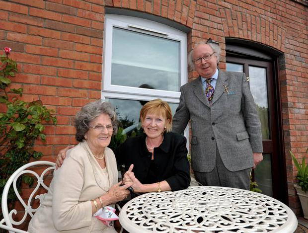 McQuillan Lodge resident Mrs Seager (left) with Lady Hermon MP and David Moore, Helm Housing group chairman