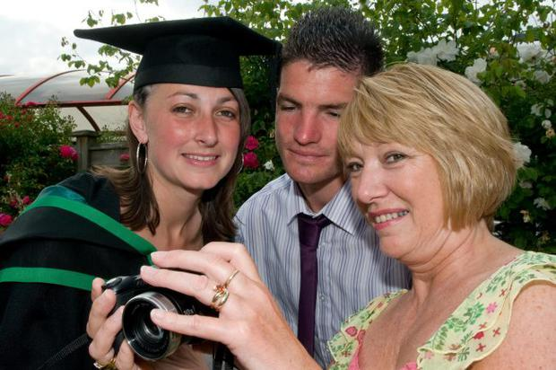 Lee-Ane Moule from Limavady who graduated from Coleraine with a BSc (Hons) Business Studies in retail pictured with Karl Rushe and mum Kay Moule