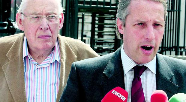 Response: Ian Paisley Jnr and his father Ian Paisley speaking outside Belfast High Court yesterday