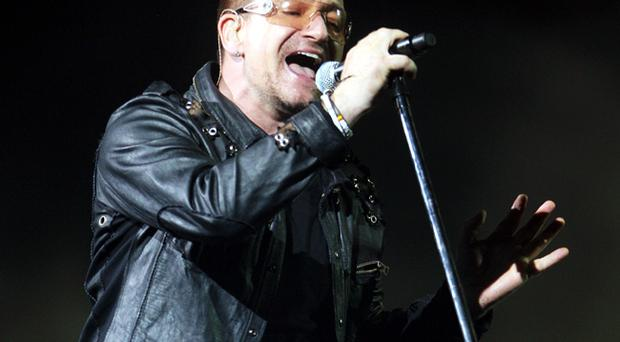 Bono of U2 performs onstage on the first night of their 360 tour held at Camp Nou on June 30, 2009 in Barcelona, Spain.