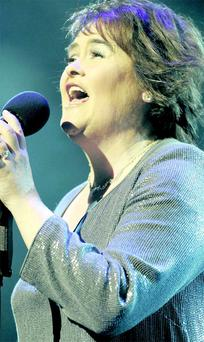 Voice of an angel: Susan Boyle belts it out on stage