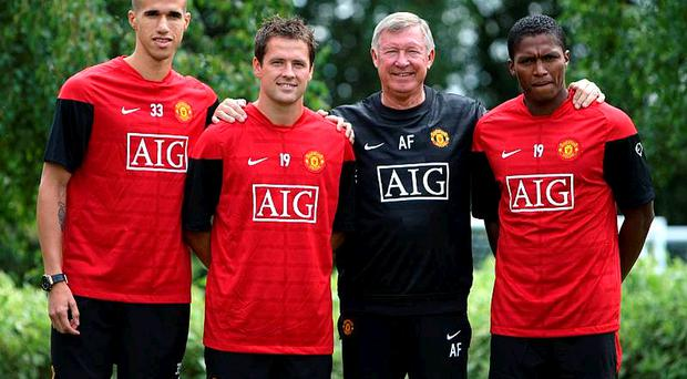 Gabriel Obertan, Michael Owen, Sir Alex Ferguson and Antonio Valencia during a press conference at Carrington Training Ground , Manchester