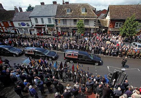 Mourners line the streets as the coffins of Trooper Joshua Hammond 18 and Lieutenant Colonel Rupert Thorneloe are slowly driven through the town of Wooton Bassett in Wiltshire after being repatriated from Afghanistan where they died last week