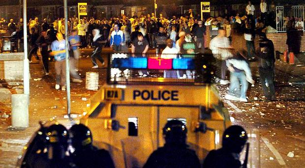 Flashpoint: Police are confronted by rioters at Ardoyne shops during a third night of rioting this week