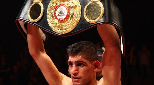 Amir Khan celebrates after defeating Andreas Kotelnik to become the WBA Light Welterweight Champion at the MEN Arena in Manchester