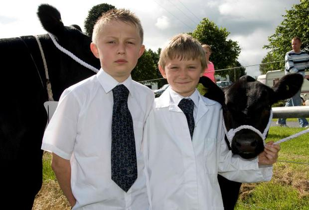 James and David Rea from Nutts Corner, with Kim the Aberdeen Angus calf