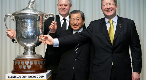 New Zealand Rugby Union CEO Steve Tew, Japan Rugby Football Union Vice President Noboru Mashimo and Australian Rugby Union Deputy CEO Matt Carroll pose with the trophy during the Bledisloe Cup Tokyo 2009 press conference at Tepia on June 30, 2009 in Tokyo, Japan