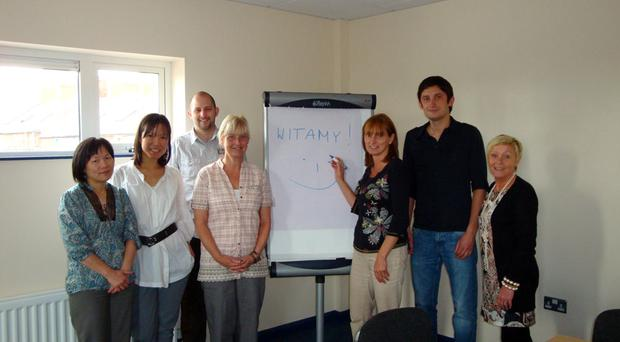 Community representatives from the greater Village getting Polish lessons