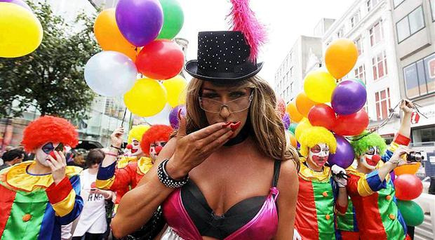 Having fun: Baroness Titty Von Tramp with an entourage of colourful clowns
