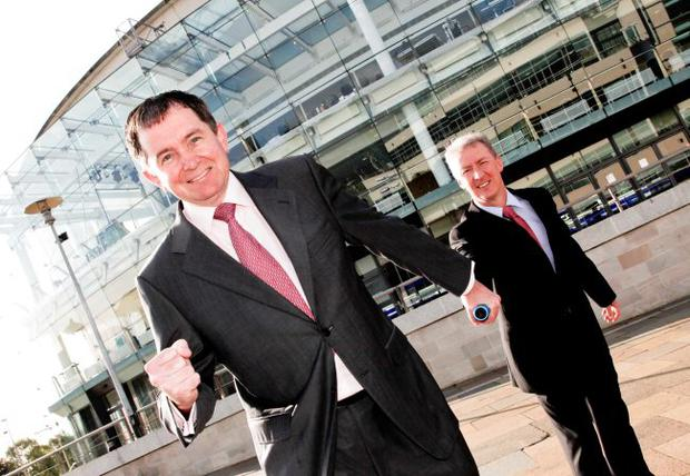 Paul Rooney, partner at PricewaterhouseCoopers, receives the baton from Michael Ryan, Bombardier vice-president and general manager, as he takes over as new chair of Business in the Community, Northern Ireland