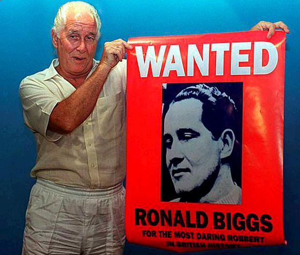Ronnie Biggs uses a wanted poster to promote his book Odd Man Out in 1994
