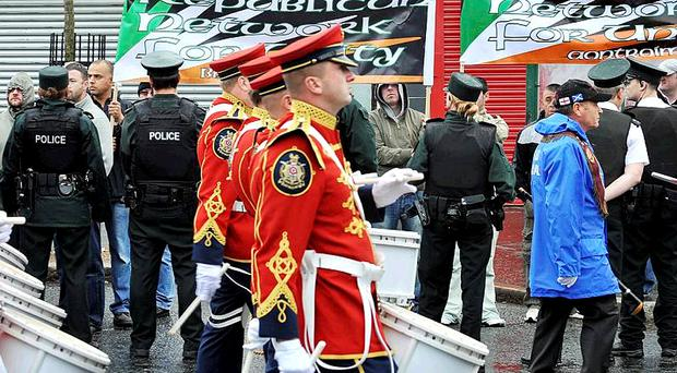 Republicans protest at Ardoyne in Belfast this morning as the Apprentice Boys parade passes through
