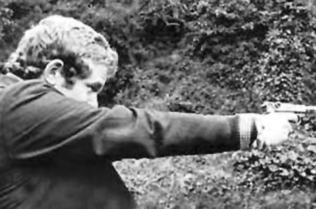 In the past: Martin McGuinness pictured brandishing a gun