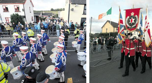 Stand-off: Loyalist bandsmen and villagers in Rasharkin last night