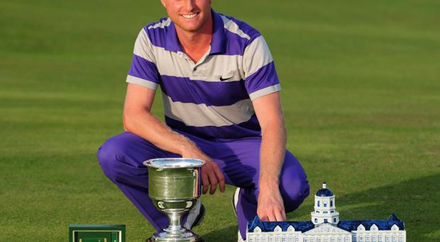 Simon Dyson of England poses with the trophy after winning the KLM Open