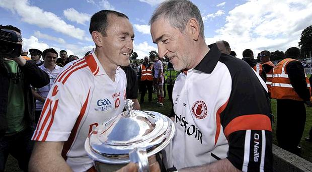 Tyrone manager Mickey Harte and captain Brian Dooher after the 2009 Ulster final