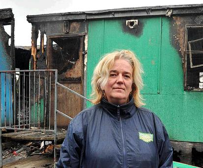 Principal Aedin Geary of Bunscoil Bheanna Boirche outside the destroyed building