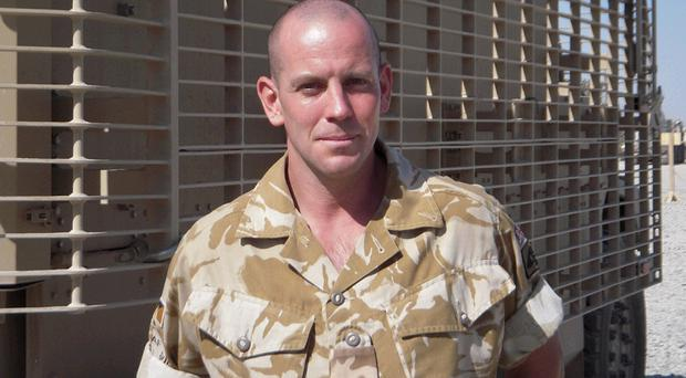 Risky business: TA soldier Lance Corporal David Holdsworth, a former Lisburn City Council worker, is in Afghanistan with 152 Ulster Transport Battalion