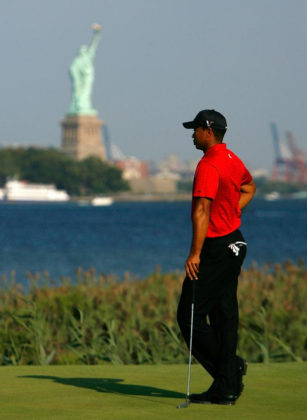 Tiger Woods waits for his birdie putt on the 14th green during the final round of The Barclays on August 30, 2009 at Liberty National in Jersey City, New Jersey