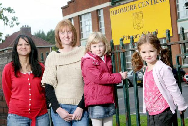 Emma Frost and Senga Coulter along with her Daughter Hannah (aged 4) and Emma's Daughter Lily(aged 4)pictured outside Dromore Primary School in Co. Down Senga and Emma have been trying to get their children places in Dromore PS but have been told that another school has been allocated to them but they say it is to far to travel.