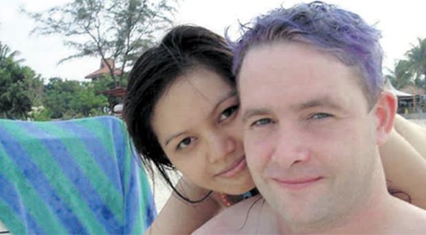 Happy life: Ballyclare merchant seaman Adrian White and his Indonesian girlfriend before his tragic death on August 29