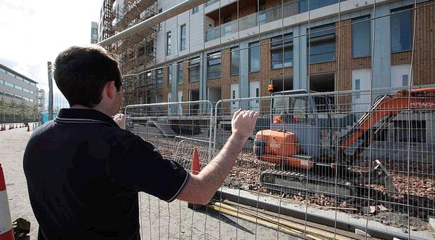 Victim of the property slump: Ben outside the new apartments at the Harcourt Construction site in Belfast's Titanic Quarter