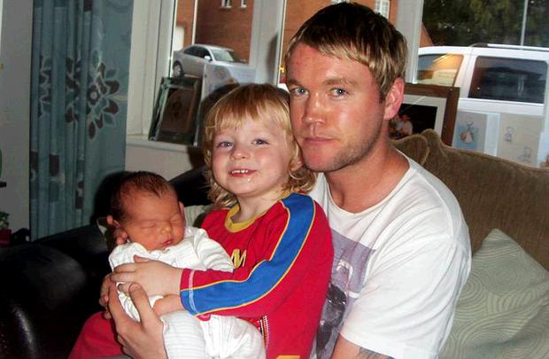 Grant McCann and son Bayley are joined by the family's new arrival, Jesse