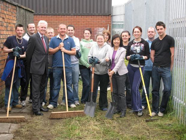 Anna Lo (front right), chief executive of Business in the Community John Heslip (left), and the Halifax team