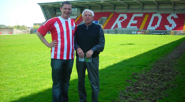 Former Cliftonville star Tommy Waugh (right) pictured at Solitude with Reds fan Paul Kerr