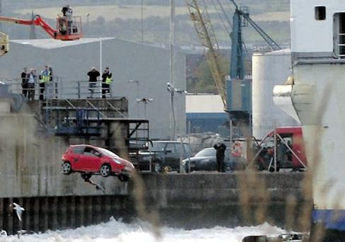 Making a splash: the little Renault Twingo plunges into the Lagan as the water is churned up by the engines of the Stena HSS
