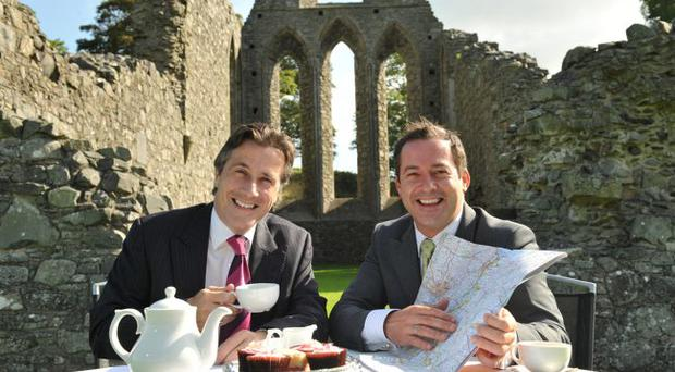 Dr Tim Campbell, director of Saint Patrick's Visitor Centre and Kevin Smyth sign off Downpatrick's new hotel